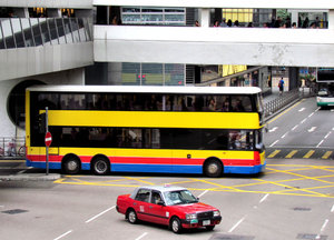turning traffic: double-decker bus and taxi turning at cross roads in Hong Kong