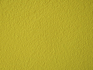 yellow textured wall: textured yellow wall