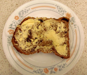 fruitloaf slice3: a toasted buttered slice of fruitloaf bread