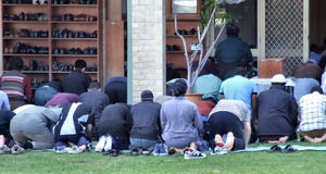 gathering for prayers6: Muslim men gathering for Friday prayer at mosque - outside overflow