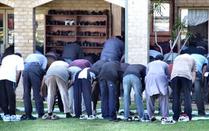 gathering for prayers5: Muslim men gathering for Friday prayer at mosque - outside overflow