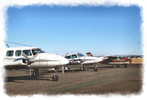 parked before take-off1: painted style image of small planes on tarmac prior to take-off