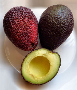 ripe avocado variety3: ripe avocados - cross section and seed impression