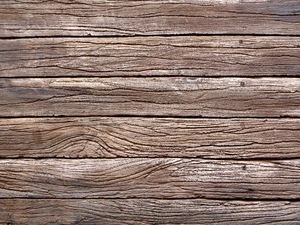 make-believe timber fence: coloured woodgrain textured concrete slab fence surface