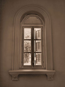 window view2: sepia image of historic arched window view