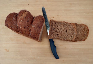 on the bread board1: wholemeal brown bread loaves variety