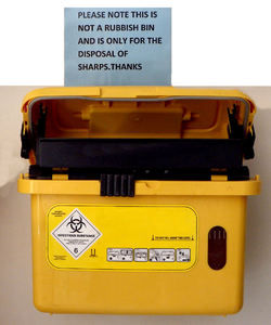 sharp disposal: special disposal bin for used needles and other sharp used hospital objects