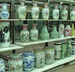 in a china shop1: shelves of Chinese ceramic  jars, pots, stools,