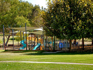 shaded park playgrd1: children's playground equipment in shaded suburban park