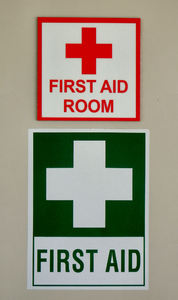 available help: signs showing medical emergency assistance location and availability
