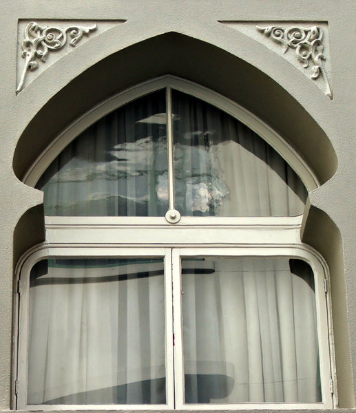 arabesque framed window: decorated Eastern style window frame