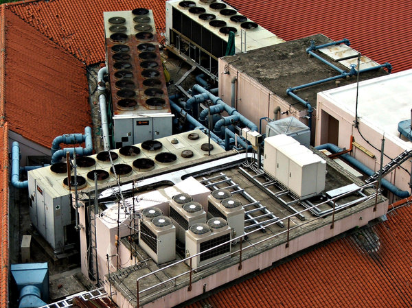 rooftop aircons: looking down on a number and variety of rooftop air conditioning units