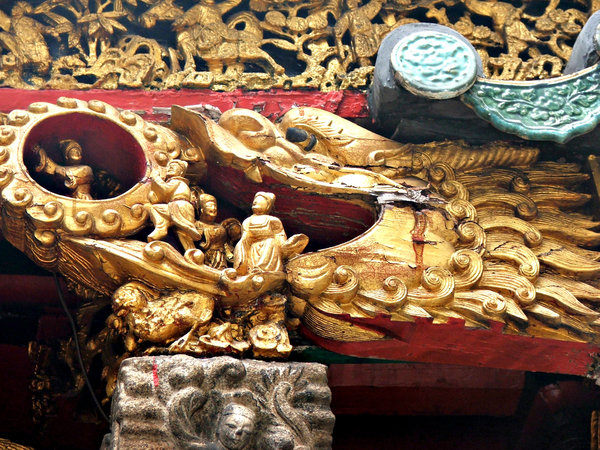 temple wall decorations: elaborately carved, decorated and gilded elements of temple wall and ceiling