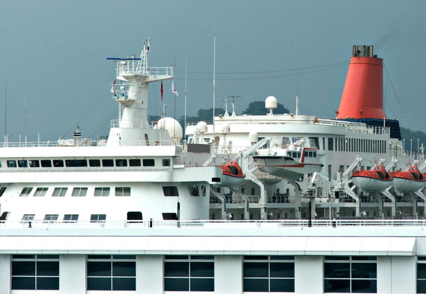 big and small: life boats and motor boat on large passenger ship