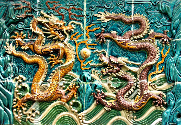 dragon wall: dragon decorated wall alongside public footpath