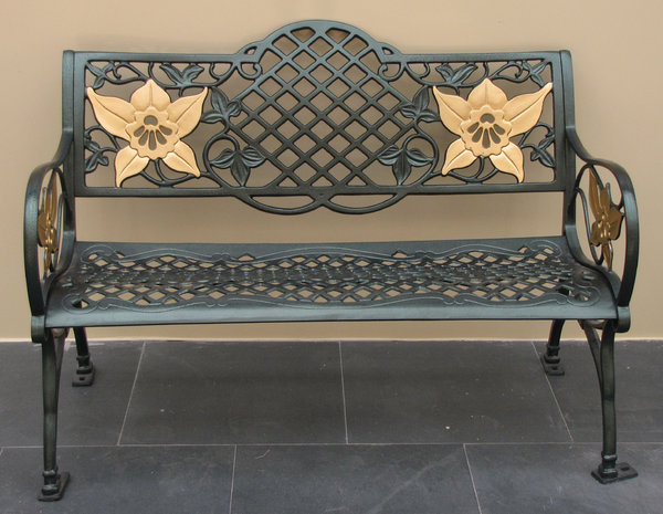 flowery seat: metal bench seat decorated with golden painted orchid flowers