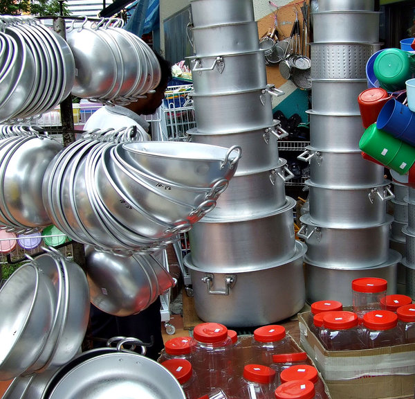 pots and pans: variety of pots, pans, containers, on display and for sale
