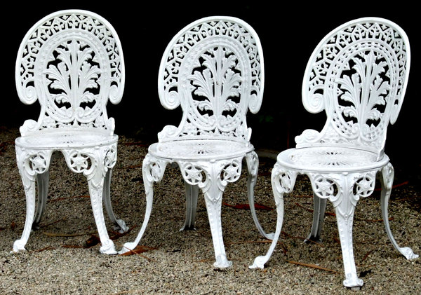 elegance not comfort: white painted cast iron garden seats - chairs