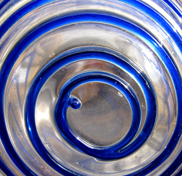 spiralling in blue: dusty outdoors glass garden ornament with blue spirals