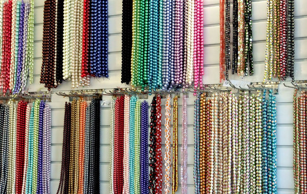 hanging beads: strings of colourful beads - necklaces