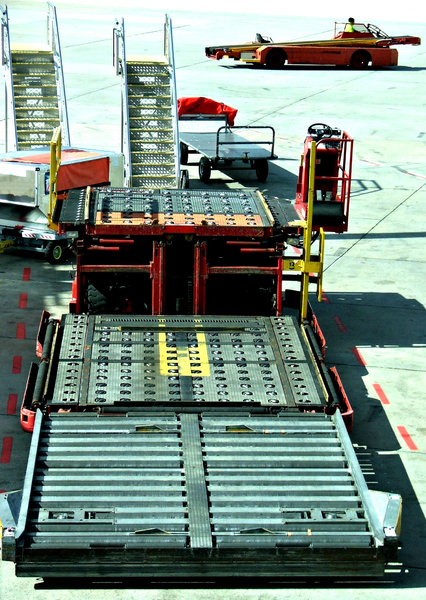 tarmac transport: airport tarmac luggage trolley train, stairs, tarmac vehicle