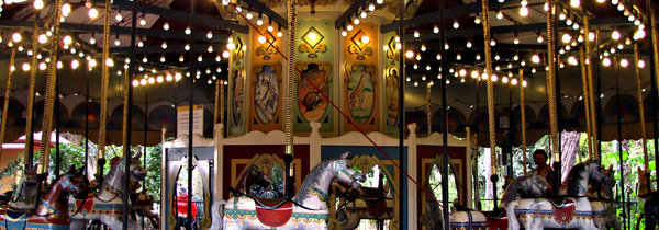 on the roundabout: a carnival's children's horse carousel - merry-go-round
