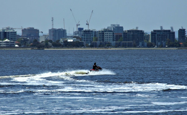 jet splash: jet skiing on the Swan River, Perth, Australia