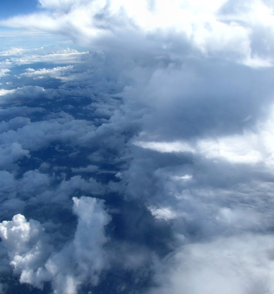 above and below6: clouds seen through plane window during flight