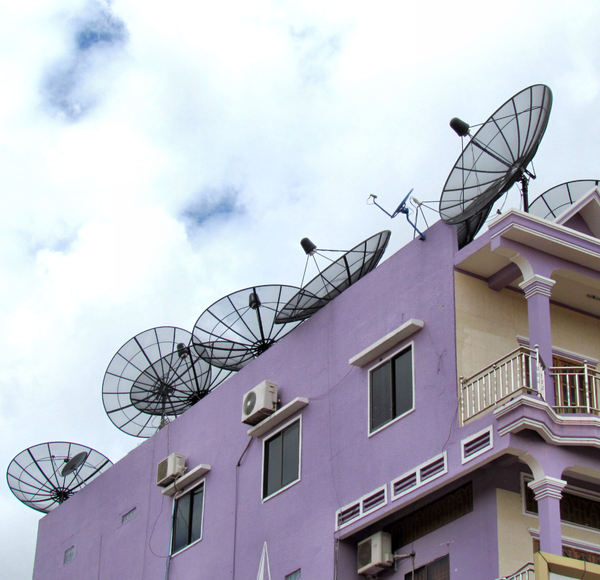 rooftop technology1: satellite dishes on Cambodian multi-storey building