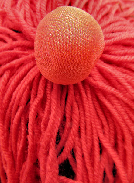 fabric ball and strands: red cap ornaments of fabric and wool
