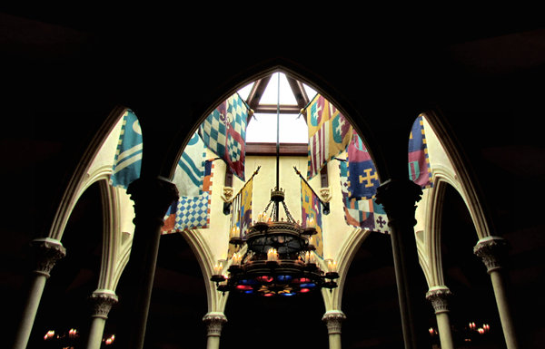 gothic light display1: arches, flags and chandeliers in old gothic style architecure