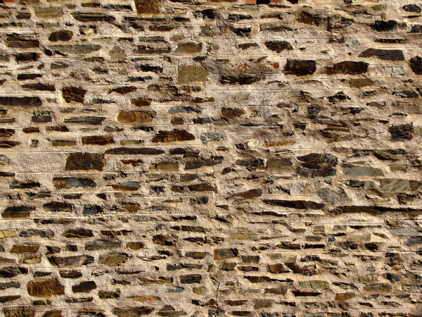 stone patchwork2.: historic wall made up of patchwork of stone surfaces & types