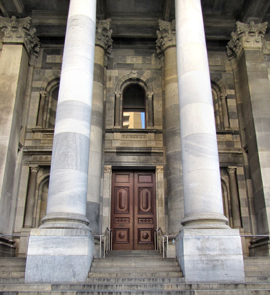 pillared doorway entrance1: historic government building with solid entrance doors on top of pillared steps