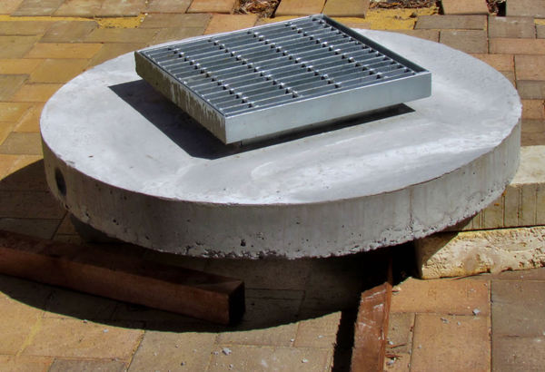 hard top1: concrete lid and metal grille for soak well