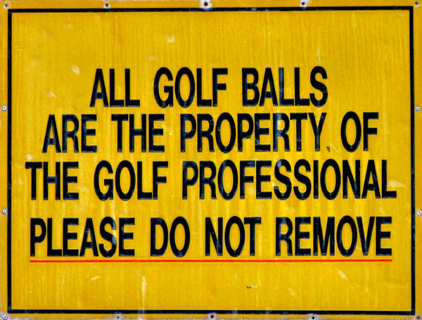 golf ball warning: golf course warning sign