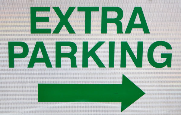 additional parking1: sign indicating direction for additional parking