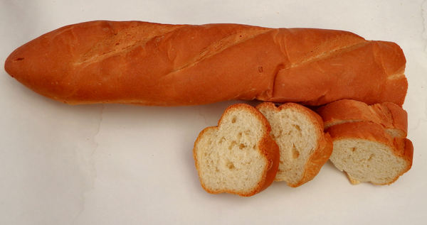 French loaf1: a cut long French stick bread loaf