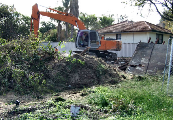 demolition job3: suburban house demolition with excavator