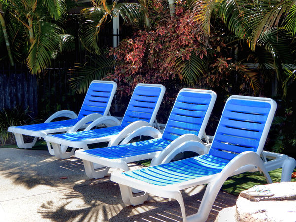 lounging by the pool1: sunloungers near the pool