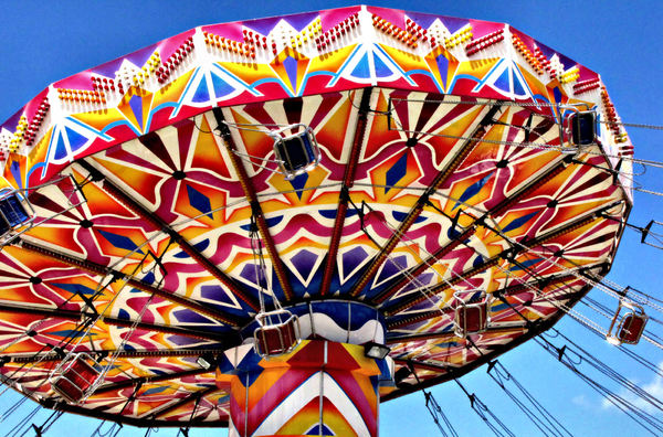 around in circles8b: colourful rotating fairground rides