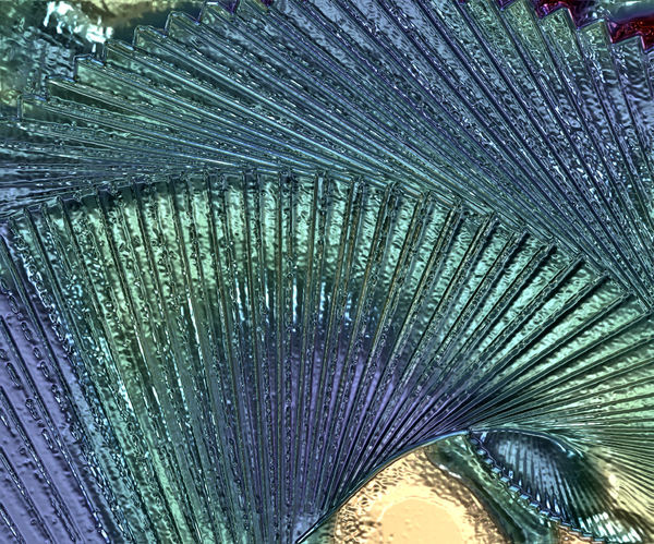 fanned textured glass: abstract of fanned out blue-green glass tiles