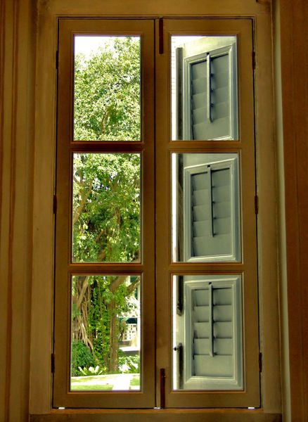 window view2: looking out through shuttered window of historic building