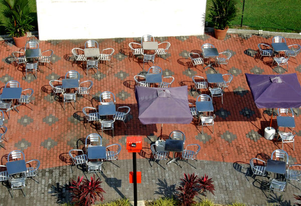 outdoor dining ambience1: looking down on outdoor dining setting in warm sunshine