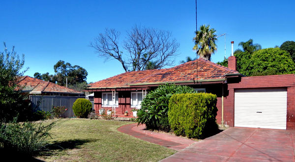 traditional suburban home1: front-yard view of traditional Australian brick-and-tiled-house suburban home