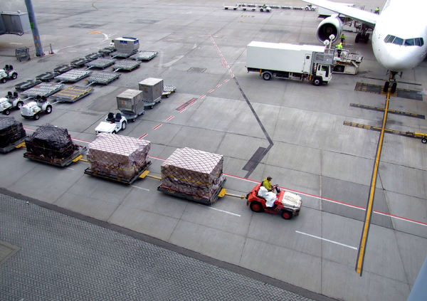 aircraft serviced in the rain2: airport tarmac vehicles and trolleys – unloading and loading international flight
