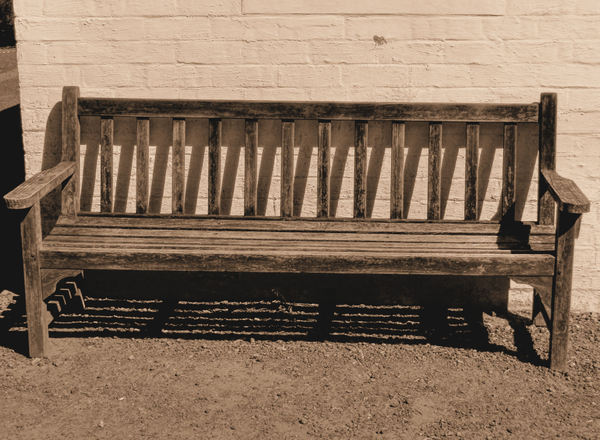 historic home bench seat1sp: sepia image of historic home's outside bench seat