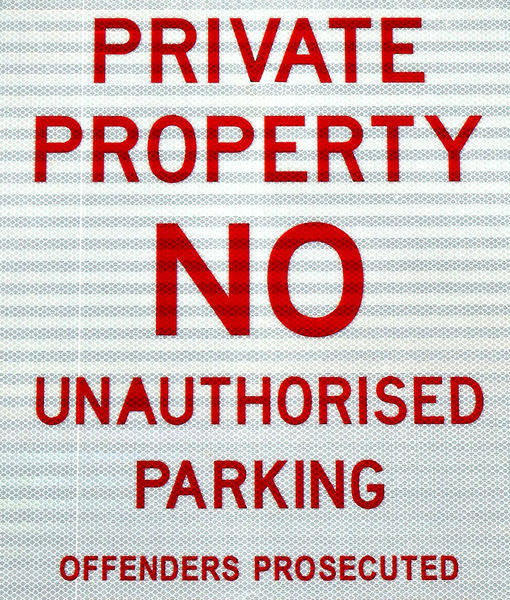 private & NO parking: reflective private property sign warning against unauthorised parking