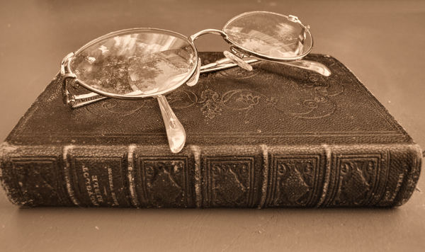 Bible & glasses1sp: sepia image of historic polyglot Bible with reading glasses/spectacles