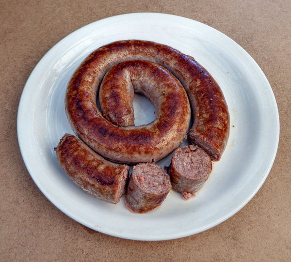 boerewors4: South African national beef sausage (with spices & other ingredients) – content & quality protected by legislation  -- cooked, cut, ready to serve