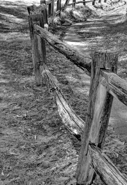 weathered wooden fencing1: black and white image of part of old neglected rustic weathered wooden fence